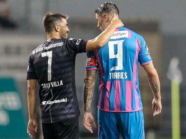 "<span class=""element-image__caption"">Fernando Torres gets his chat on with David Villa after the game.</span> <span class=""element-image__credit"">Photograph: Jiji Press/AFP/Getty Images</span>"
