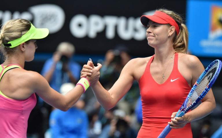 "Canada's Eugenie Bouchard (L), pictured in 2015 after a match against Maria Sharapova, recently called out Sharapova as being a ""cheater"" and suggested the Russian should be kicked out of tennis for life"