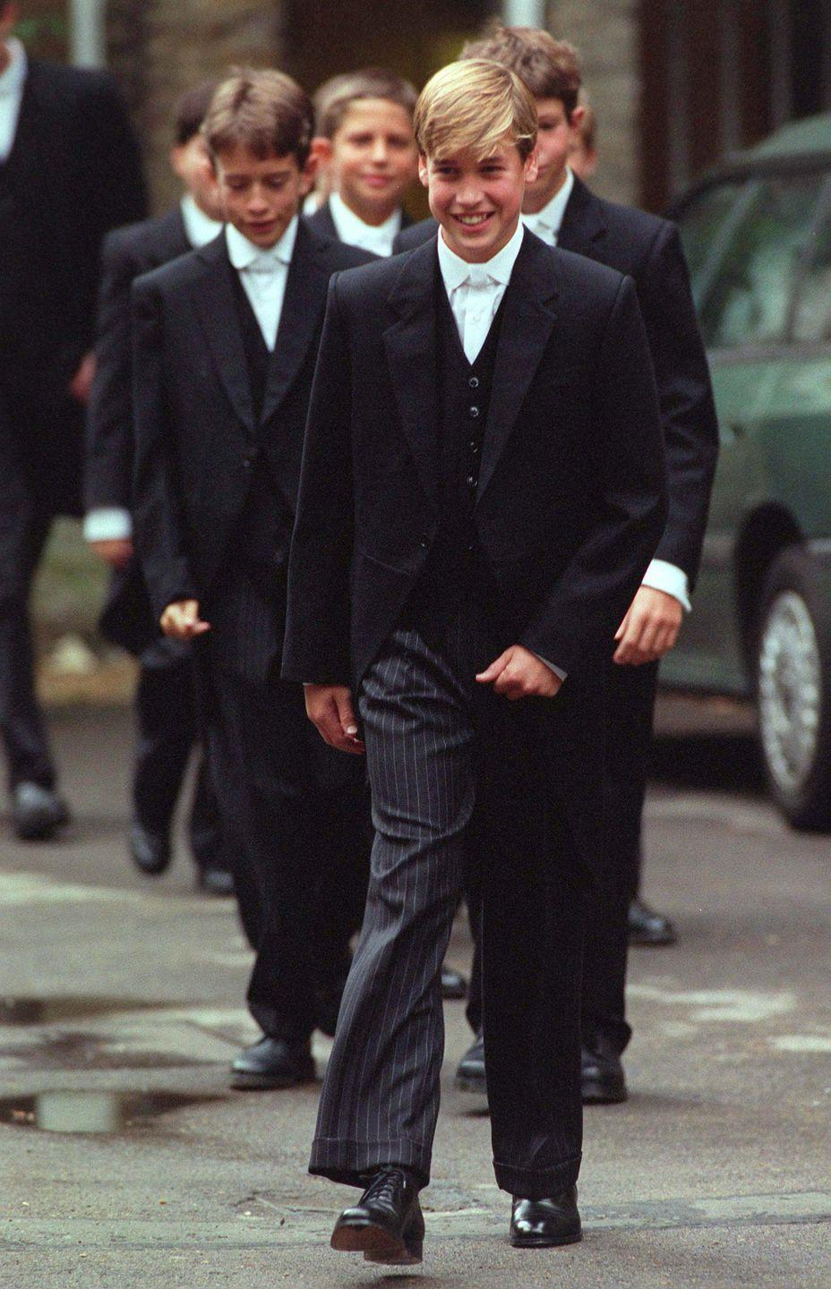 <p>Prince William looked proud as punch marching into his first day at Eton College on September 16, 1995. And didn't he look smart wearing the traditional fancy Eton uniform - a black tailcoat, black waistcoat, pinstriped trousers and white tie?</p>