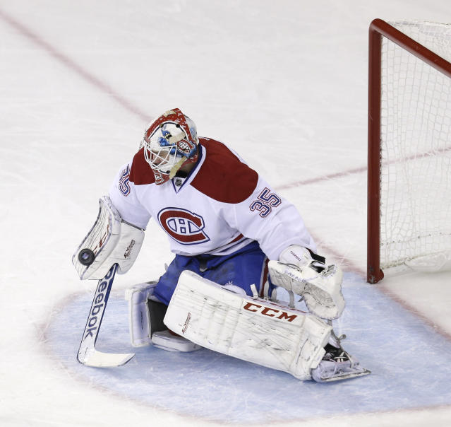 Montreal Canadiens goalie Dustin Tokarski makes a save during the first period of Game 4 of the NHL hockey Stanley Cup playoffs Eastern Conference finals against the New York Rangers, Sunday, May 25, 2014, in New York. (AP Photo/Seth Wenig)