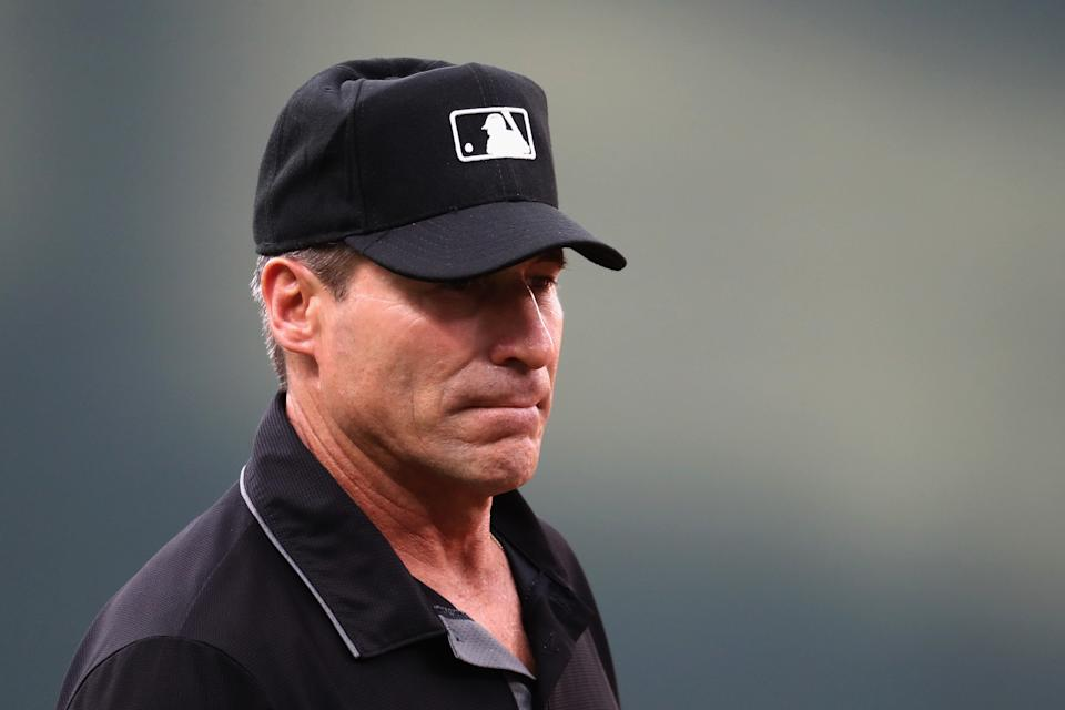 BALTIMORE, MD - AUGUST 02: Third base umpire Angel Hernandez #55 looks on in the first inning of the Baltimore Orioles and Kansas City Royals game at Oriole Park at Camden Yards on August 2, 2017 in Baltimore, Maryland.  (Photo by Rob Carr/Getty Images)