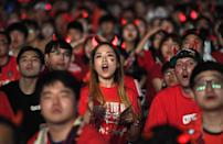 <p>South Korean football fans watch on a large screen during a street cheering event for their team's 2018 World Cup match against Sweden at Gwanghwamun square in Seoul on June 18, 2018. (Photo by Jung Yeon-je / AFP) </p>