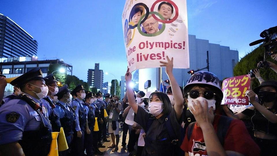 """<div class=""""paragraphs""""><p>Japanese nationals protesting against the Olympics</p></div>"""