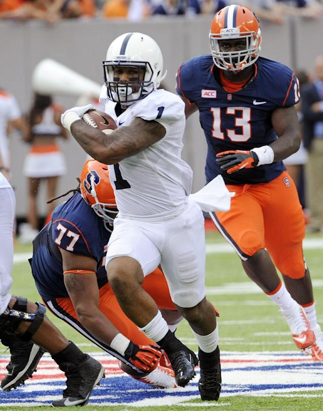 Penn State running back Bill Belton (1) breaks away from Syracuse tackle Zian Jones (77) and Ron Thompson (13) and during the second quarter of an NCAA college football game Saturday, Aug. 31, 2013, in East Rutherford, N.J. (AP Photo/Bill Kostroun)