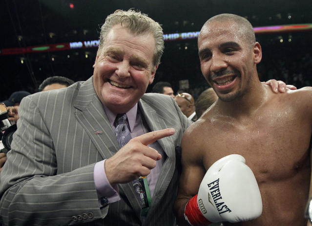 Andre Ward celebrates with promoter Dan Goossen after beating Chad Dawson (not pictured) in a super middleweight championship boxing match in Oakland, Calif., Saturday, Sept. 8, 2012. (AP Photo/Jeff Chiu)