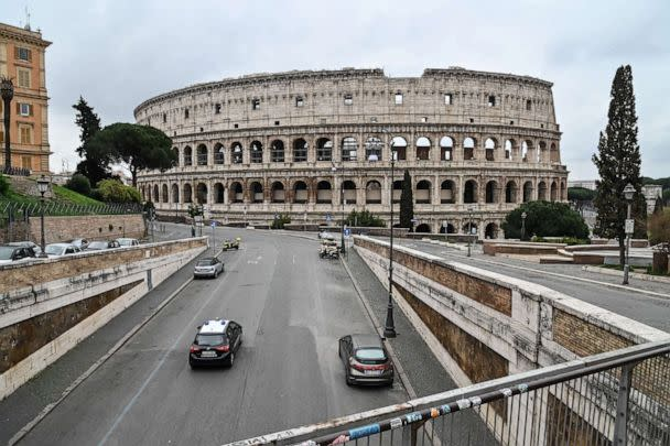 PHOTO: An Italian Carabinieri car checks the traffic of the street around ancient Colosseum, in Rome, March 14, 2020, during the COVID-19 outbreak. (Andreas Solaro/AFP via Getty Images)