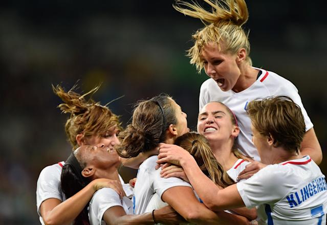 <p>Carli Lloyd of United States celebrates with her team after scoring during the Women's Group G first round match between United States and France during Day 1 of the Rio 2016 Olympic Games at Mineirao Stadium on August 6, 2016 in Belo Horizonte, Brazil. (Photo by Pedro Vilela/Getty Images) </p>