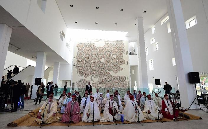 Musicians get ready to play a musical tribute in honour of the victims of the massacre of foreign tourists at Tunis' Bardo Museum, on March 29, 2015, in Tunis (AFP Photo/Emmanuel Dunand)