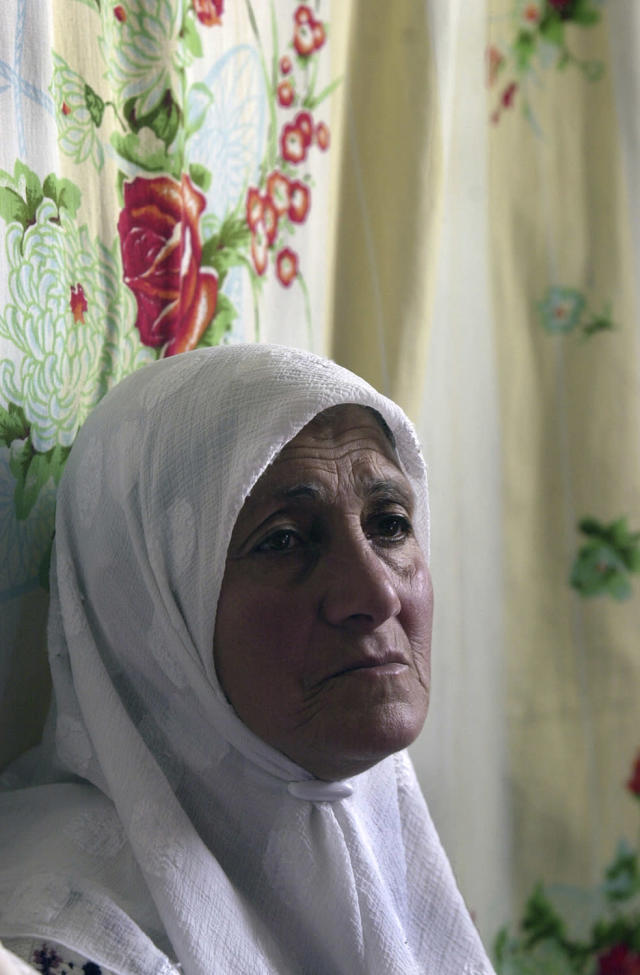 <p>A woman attends a gathering of women mourning at the family home of Andaleeb Taqtaqah, 20, in the West Bank village of Beit Fajjar, April 13, 2002. (Photo: Jacqueline Larma/AP) </p>
