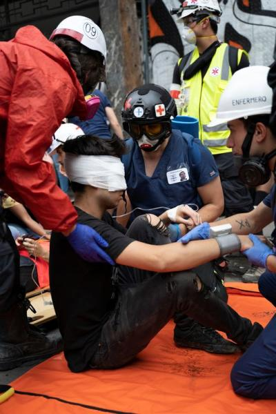 Chilean student Gustavo Gatica receive first aid care after being shot in the face by Chilean police with rubber bullets during a protests in Santiago
