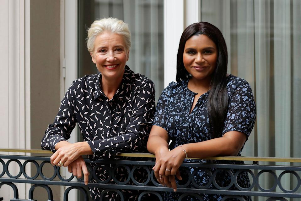 "This May 17, 2019 photo shows British actress Emma Thompson and U.S. actress and screenwriter Mindy Kaling posing on a hotel balcony in London to promote their film, ""Late Night."" (AP Photo/Matt Dunham)"