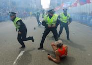 <p>2013. Police officers react immediately after an explosion near the finish line of the Boston Marathon.</p>