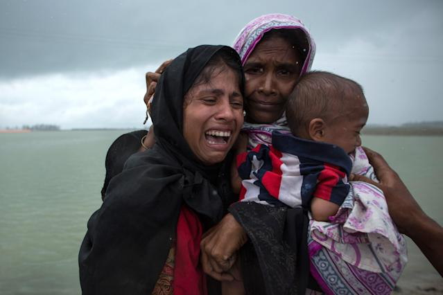 <p>Rohingya Muslim refugees react after being re-united with each other after arriving on a boat from Myanmar on Sept. 8, 2017 in Whaikhyang Bangladesh. (Photo: Dan Kitwood/Getty Images) </p>
