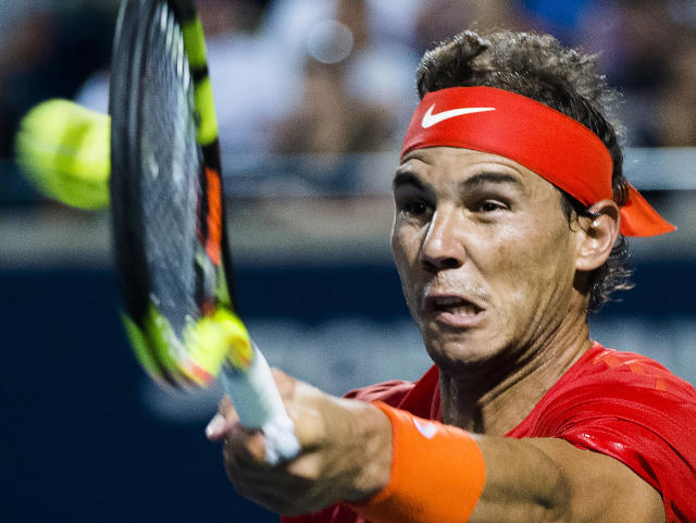Rafael Nadal, of Spain, returns the ball to Stan Wawrinka, of Switzerland, during the Rogers Cup mens tennis tournament Thursday, Aug. 9, 2018, in Toronto. (Nathan Denette/The Canadian Press via AP)