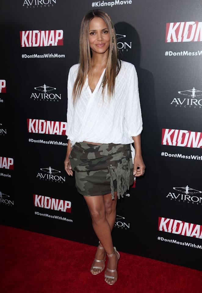 <p>Wearing a mini camouflage skirt and an oversized wrap shirt, the 50-year-old actress looked fresh-faced and incredibly youthful at the premiere of her 2017 flick, 'Kidnap'. [Photo: Rex] </p>