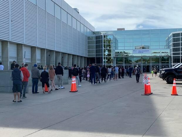 People line up to be tested at the Edmonton Expo Centre on Thursday. Alberta reported 4,740 new cases of COVID-19 over the past three days.  (Dave Bajer/CBC - image credit)