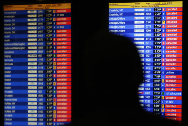 <p>An information screen shows canceled flights at the Air Train to JFK airport Wednesday, March 21, 2018, in the Queens borough of New York. (Photo: Frank Franklin II/AP) </p>