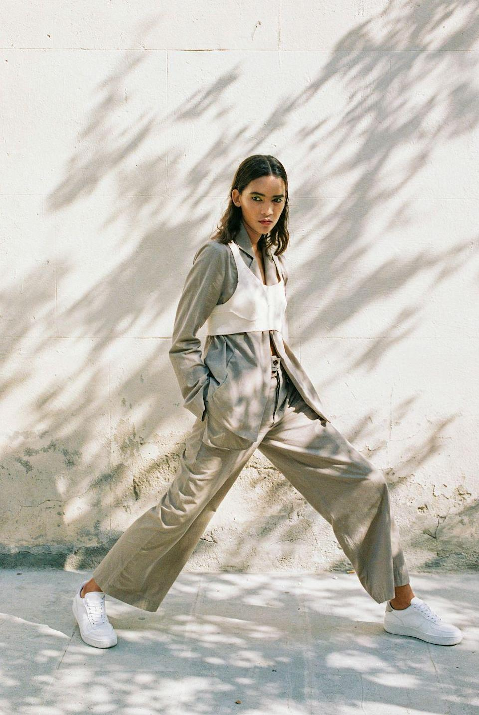 """<p>SONIA CARRASCO specialises is wearable workwear with a twist, and it's all sustainably made.</p><p>'At SONIA CARRASCO we exclusively work with recycled, organic or vegan materials, not only textiles but also tags, labels, packaging, papers, etc', founder and designer Sonia Carrasco told ELLE UK</p><p>'Having a long term plan for our company helps us activate more sustainable processes. For example, we recycle all the waste generated by the manufacturing of the collections and, as soon as we have enough quantity, create new fabrics from these leftovers therefore maximising our control over the supply chain. </p><p>'We follow the rule of """"never enough"""" - that's why we will always keep improving our processes and we will never stop researching and learning the latest technologies, innovations and possible partnerships to be in the state of the art of responsibility.'</p><p><a class=""""link rapid-noclick-resp"""" href=""""https://sonia-carrasco.com/"""" rel=""""nofollow noopener"""" target=""""_blank"""" data-ylk=""""slk:SHOP SONIA CARRASCO NOW"""">SHOP SONIA CARRASCO NOW</a></p>"""