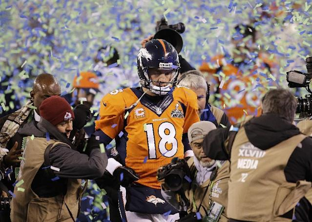 FILE - In this Feb. 2, 2014 file photo, Denver Broncos quarterback Peyton Manning walks off the field after the Broncos lost to the Seattle Seahawks in the NFL Super Bowl XLVIII football game in East Rutherford, N.J. Manning delivers the keynote address at the Boy Scouts of America's annual breakfast Wednesday, April 16, 2014 in Denver, and makes his first public comments since the Broncos were trounced by Seattle from the opening snap of the Super Bowl. (AP Photo/Chris O'Meara, File)