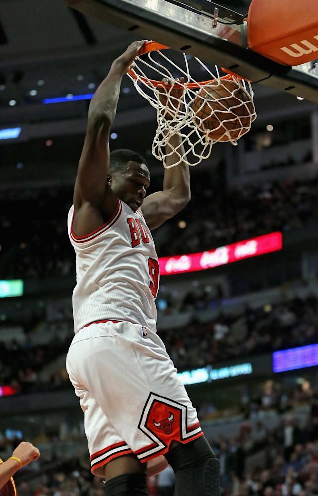 CHICAGO, IL - NOVEMBER 11: Loul Deng #9 of the Chicago Bulls dunks against the Cleveland Cavaliers at the United Center on November 11, 2013 in Chicago, Illinois. The Bulls defeated the Cavaliers 96-81. NOTE TO USER: User expressly acknowledges and agrees that, by downloading and or using this photograph, User is consenting to the terms and conditions of the Getty Images License Agreement. (Photo by Jonathan Daniel/Getty Images)