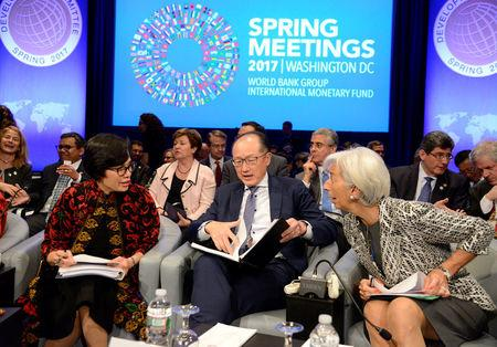 World Bank Group President Jim Yong Kim (C), IMF Managing Director Christine Lagarde (R) and Indonesia's Finance Minister Sri Mulyani Indrawati are seated  prior to the start of the Development Committee Plenary, as part of the IMF and World Bank's 2017 Annual Spring Meetings, in Washington, U.S., April 22, 2017.   REUTERS/Mike Theiler