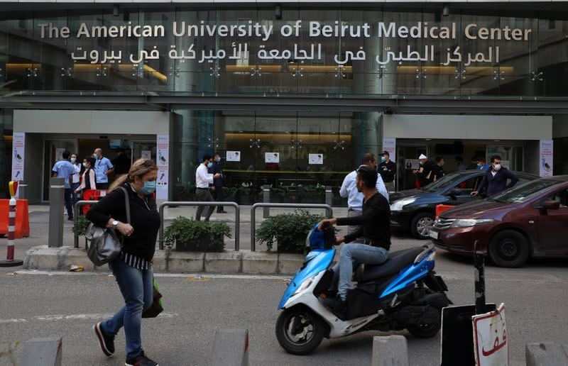 People walk outside the American University of Beirut (AUB) medical centre in Beirut