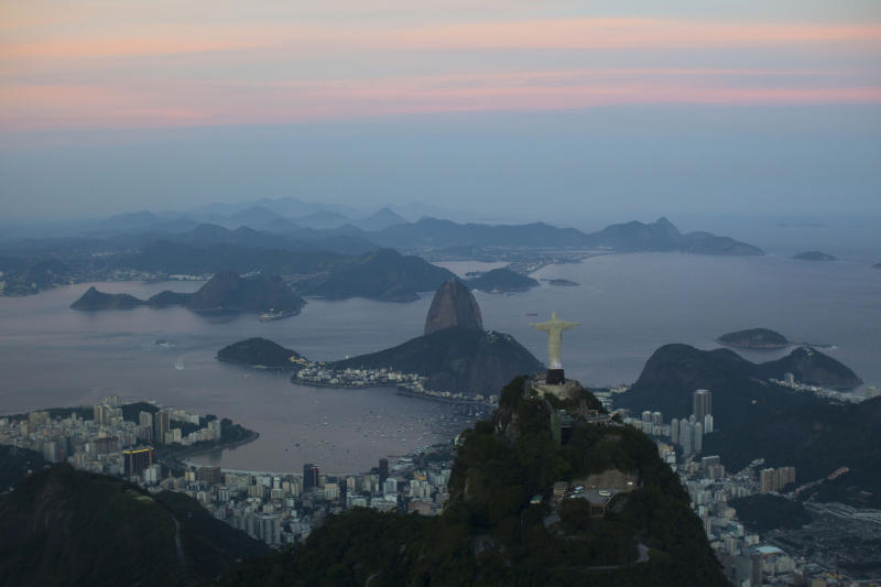 "Christ the Redeemer statue is backdropped by Sugar Loaf mountain as the sun sets in Rio de Janeiro, Brazil, Thursday, May 10, 2012. The upcoming Rio + 20 conference, billed as a ""historic opportunity"" to build a greener future, appears to be going up in smoke. President Barack Obama won't be there, and the leaders of Britain and Germany have bowed out. Entire delegations have canceled. The conference is the follow-up to the U.N.'s 1992 Earth Summit, also held in Rio, which helped put climate change on the world agenda. (AP Photo/Felipe Dana)"