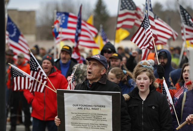 <p>Maine gun rights supporters cheer at a rally, Saturday, April 14, 2018, at the State House in Augusta, Maine. (Photo: Robert F. Bukaty/AP) </p>