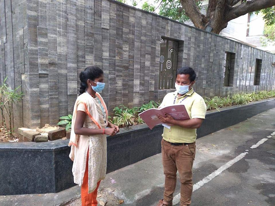 Two health volunteers take stalk of the day's programme in Chennai.