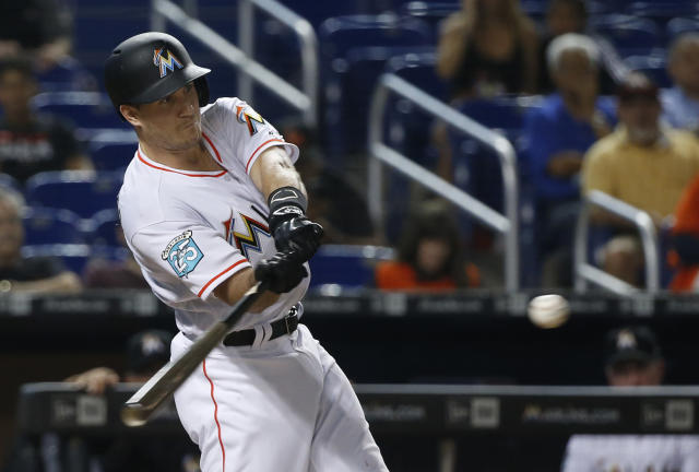 Miami Marlins' J.T. Realmuto swings for a home run during the sixth inning of the team's baseball game against the Los Angeles Dodgers, Wednesday, May 16, 2018, in Miami. The Marlins won 6-5. (AP Photo/Wilfredo Lee)