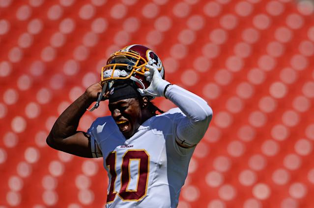 LANDOVER, MD - AUGUST 24: Quarterback Robert Griffin III #10 of the Washington Redskins takes off his helmet before playing the Buffalo Bills during a preseason game at FedExField on August 24, 2013 in Landover, Maryland. (Photo by Patrick Smith/Getty Images)