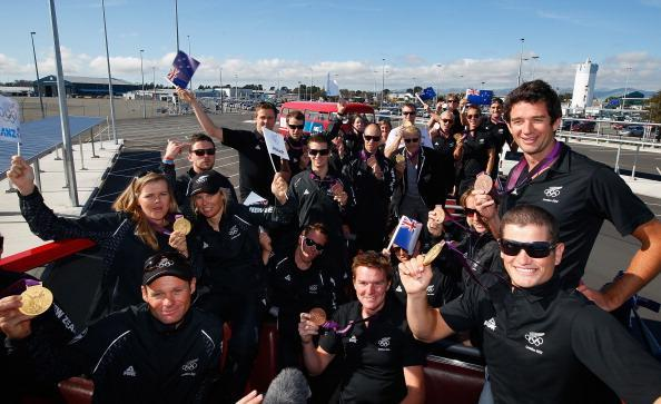 Olympians pose on the top deck of the bus before they travel to the New Zealand Olympic homecoming ceremony at Pioneer Stadium on August 24, 2012 in Christchurch, New Zealand. (Photo by Sandra Mu/Getty Images)