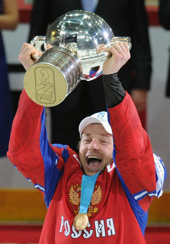 Russia's captain Ilya Nikulin celebrates with the trophy of the IIHF International Ice Hockey World Championship after winning the final game between Russia and Slovakia in Helsinki on May 20, 2012. Russia defeated team Slovakia 6-2 .   AFP PHOTO/ ALEXANDER NEMENOVALEXANDER NEMENOV/AFP/GettyImages