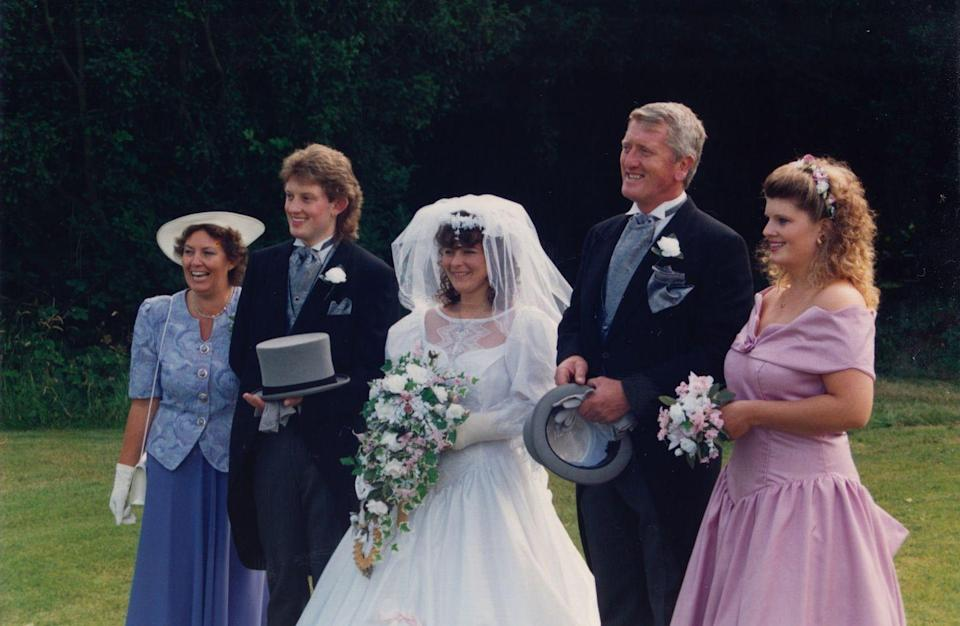 <p>Lace wedding dresses continued well into the '90s, including at this English countryside affair. </p>