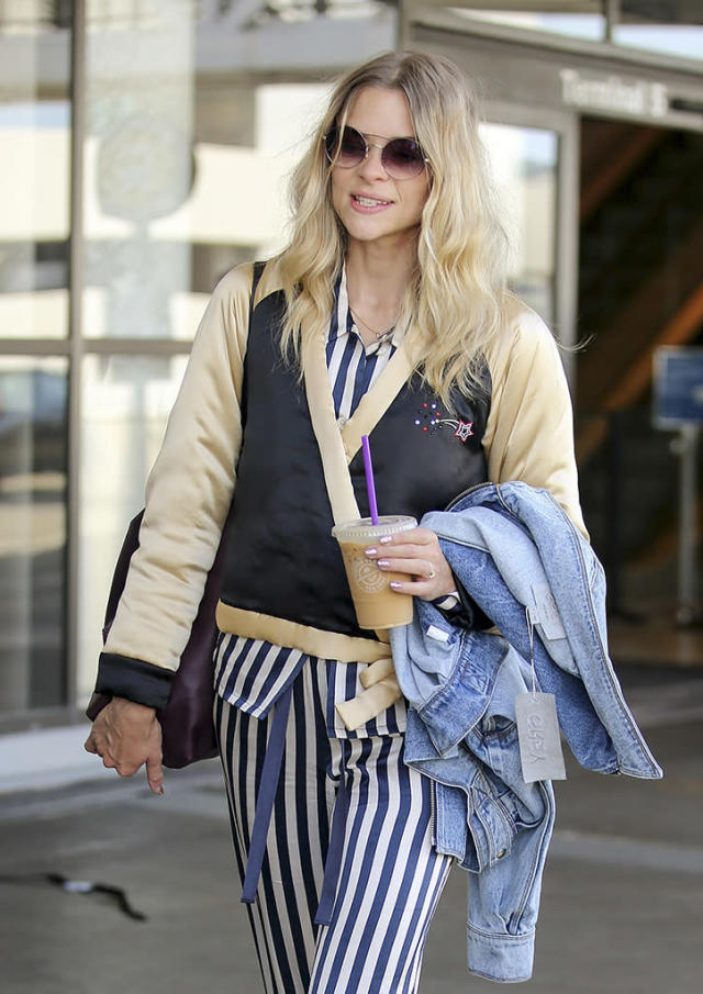 <p>King obviously needed to drink more of her iced coffee to get started during her visit to the L.A. airport. She forgot to take the tag off her new denim jacket. (Photo: Splash News) </p>