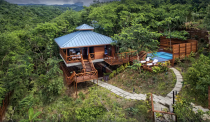 """<p>This intimate Caribbean hideaway—called Secret Bay—is a dreamy setting for a romantic retreat. It features everything from an open-air kitchen and barbeque to a private plunge pool and outdoor shower.</p><p><a class=""""link rapid-noclick-resp"""" href=""""https://go.redirectingat.com?id=74968X1596630&url=https%3A%2F%2Fwww.expedia.com%2FPortsmouth-Hotels-Secret-Bay.h4748737.Hotel-Information&sref=https%3A%2F%2Fwww.housebeautiful.com%2Fdesign-inspiration%2Fhouse-tours%2Fg3301%2Famazing-tree-house-homes%2F"""" rel=""""nofollow noopener"""" target=""""_blank"""" data-ylk=""""slk:BOOK NOW"""">BOOK NOW</a> <strong><em>Secret Bay</em></strong></p>"""