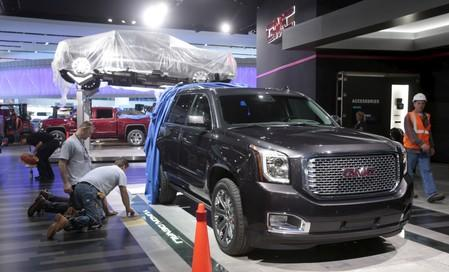 FILE PHOTO: A GMC 2016 Yukon Denali pickup truck is displayed on the show floor as carpenters work on the GMC display stand before press days of the North American International Auto Show at Cobo Center in Detroit