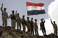 Yemeni army soldiers who defected to the opposition wave their national flag in Sanaa. A Gulf mediator flew out on Sunday after failing to secure Yemeni President Ali Abdullah Saleh's signature on a transition deal for him to quit office, although his ruling party signed the accord