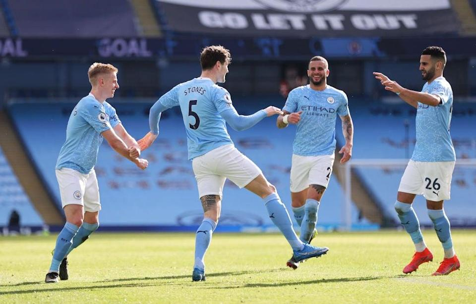<p>John Stones celebrates with team mates Kyle Walker, Riyad Mahrez and Oleksandr Zinchenko</p> (Getty)