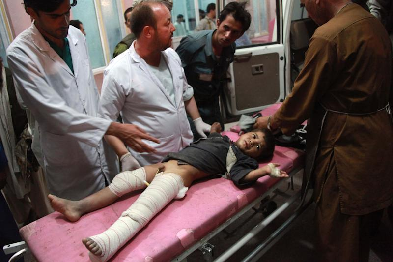 An injured Afghan child is treated at a hospital after a roadside bomb in the Obi district of Herat, west of Kabul, Afghanistan, Tuesday, July 9, 2013. A roadside bomb killed 17 civilians, including four children, in western Afghanistan on Tuesday. (AP Photo/Hoshang Hashimi)