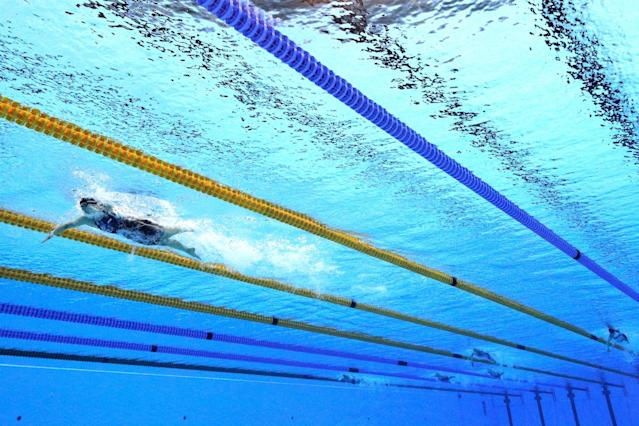 <p>Katie Ledecky of the United States leads the field in the Women's 800m Freestyle Final on Day 7 of the Rio 2016 Olympic Games at the Olympic Aquatics Stadium on August 12, 2016 in Rio de Janeiro, Brazil. (Photo by Adam Pretty/Getty Images) </p>