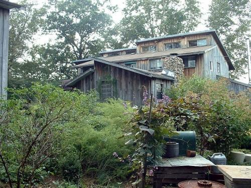 The TaChai house is home to the Twin Oaks Community's hammock shop and has several bedrooms above. <br>
