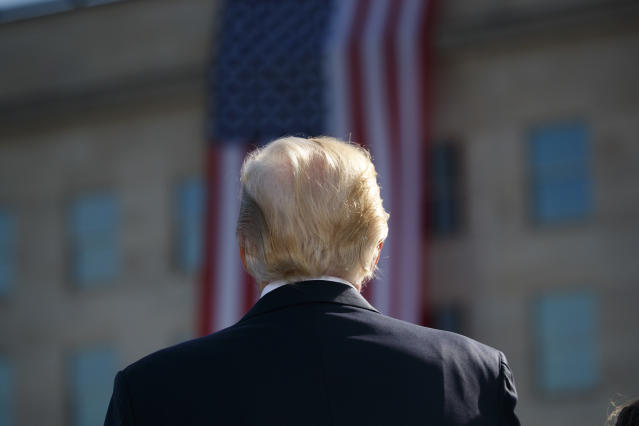 <p>President Donald Trump stands for the national anthem during a ceremony to mark the anniversary of the Sept. 11 terrorist attacks, Sept. 11, 2017, at the Pentagon. (Photo: Evan Vucci/AP) </p>