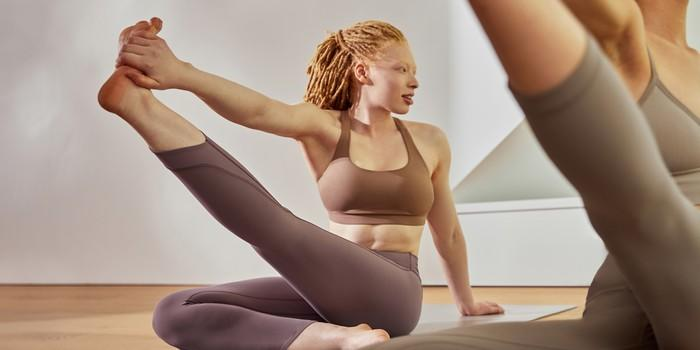 A woman attends a yoga class.