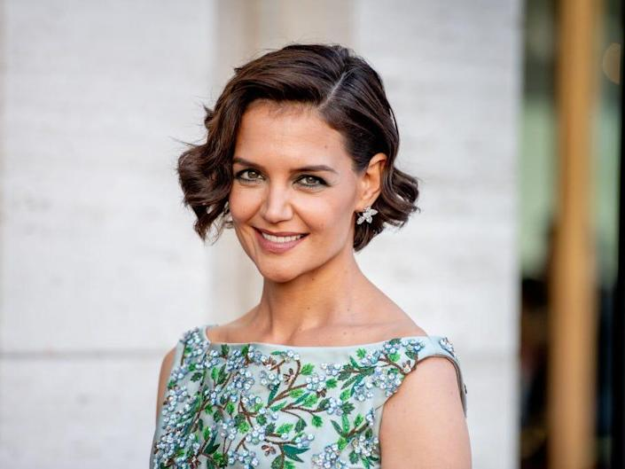 Katie Holmes smiles at an event.