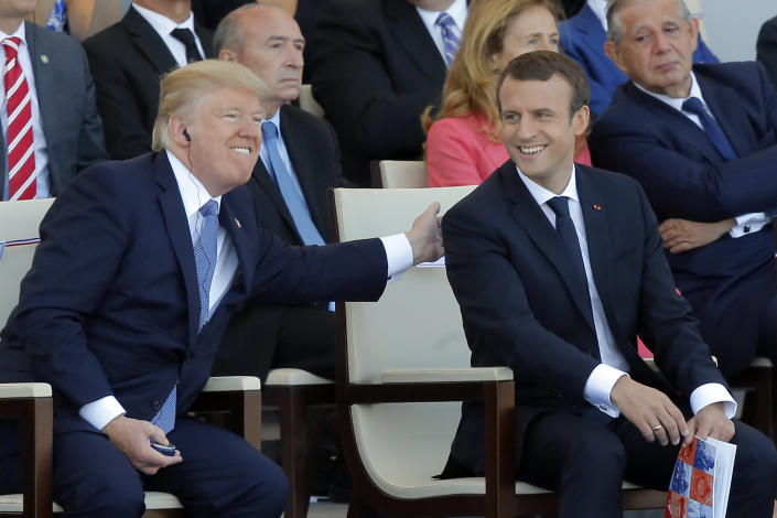President Trump and French President Emmanuel Macron attend the traditional Bastille Day military parade in Paris. (Photo: Michel Euler/AP)
