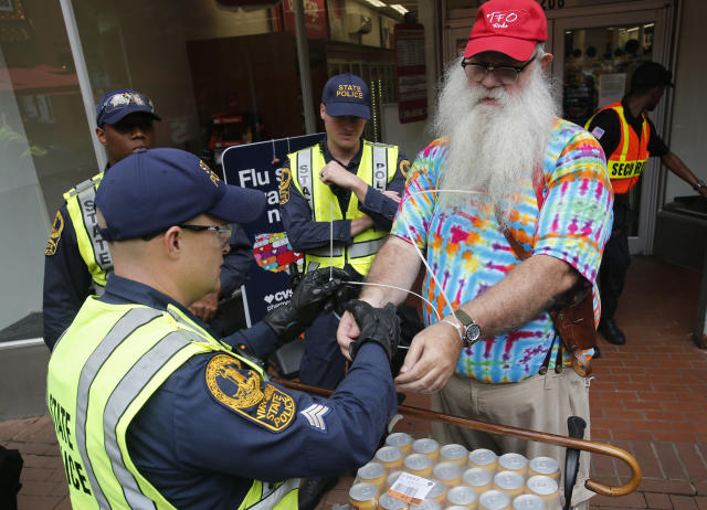 <p>State Police arrest a local resident, John Miska, in the locked down downtown area in Charlottesville, Va., Saturday, Aug. 11, 2018. Miska purchased razor blades, which are banned items, in a downtown drugstore. (Photo: Steve Helber/AP) </p>