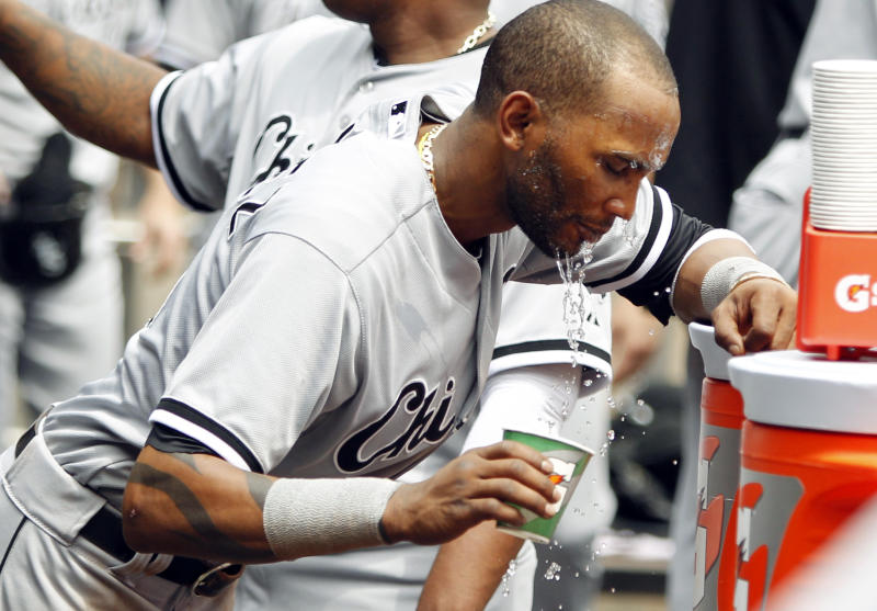 Chicago White Sox shortstop Alexei Ramirez cools off in the dugout during a baseball game against the Minnesota Twins, Thursday, June 20, 2013, in Minneapolis. (AP Photo/Genevieve Ross)