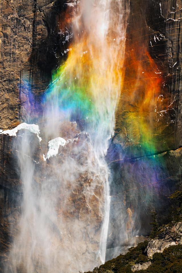 PIC BY NOLAN NITSCHKE / CATERS NEWS - (PICTURED A stunning rainbow at a waterfall in Yosemite) This is the spectacular moment a photographer struck gold - by capturing a bolt of lightning cracking through a rainbow in a freak weather display. The extraordinary one-of-a-kind sighting was captured by keen photographer Nolan Nitschke, 27, while on a trip to Yosemite National Park in California, USA. Nolan knew a storm was approaching the area and that the incredible rocky peaks throughout the park act as lightning rods but had no idea he would capture such a breathtaking moment. After spending hours painstakingly trying for the perfect shot he finally hit the jackpot as the bright lightning crashed through the colourful rainbow lighting up the dark sky. SEE CATERS COPY