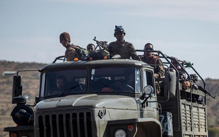 Ethiopian government soldiers ride in the back of a truck north of Mekelle last month - AP